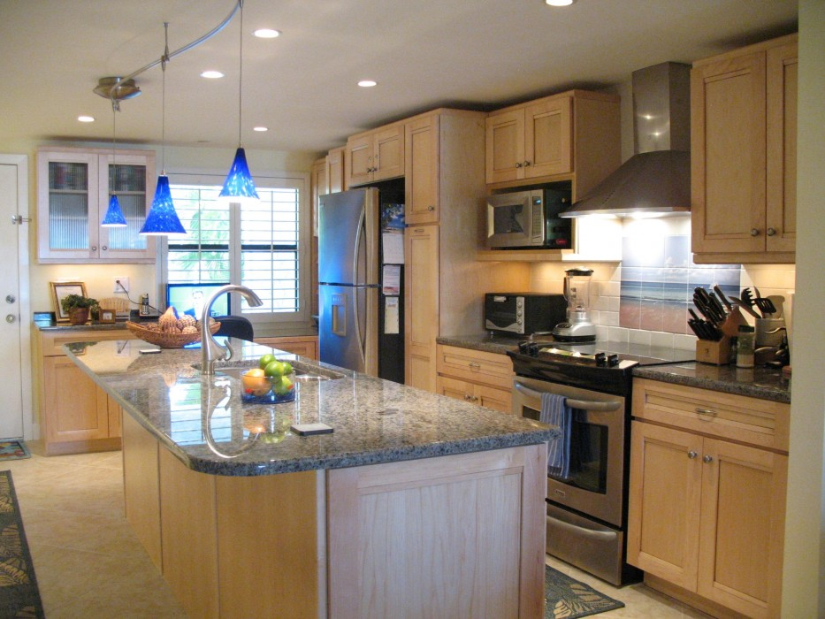 The open kitchen seats five, with granite counter-tops and all the modern conveniences