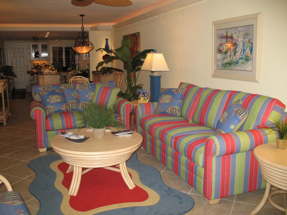 The living room is decorated in tropical colors