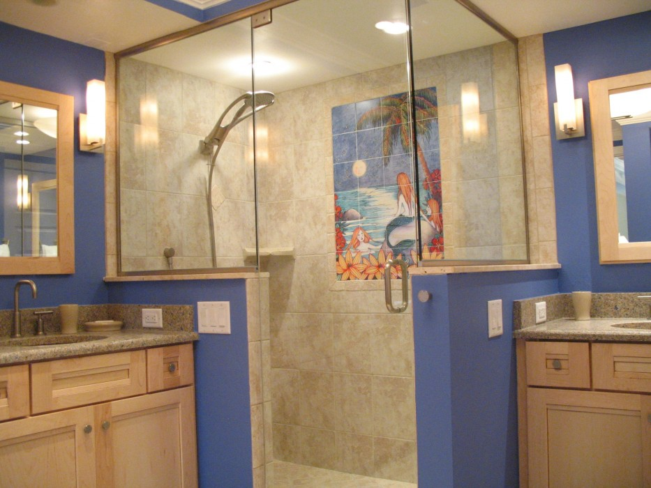 Master bath has walk-in shower with tile mural and two vanities