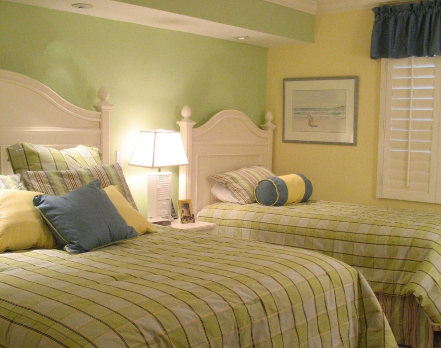 The guest bedroom has queen and extra-long twin beds