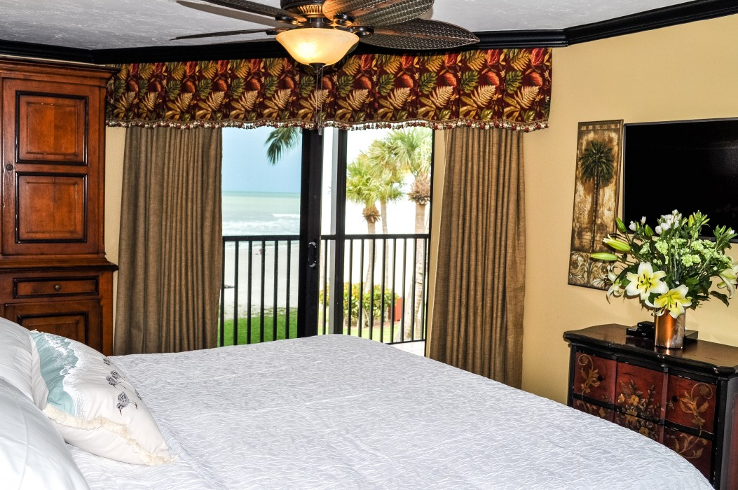 Hear the waves and see the surf from this romantic master suite