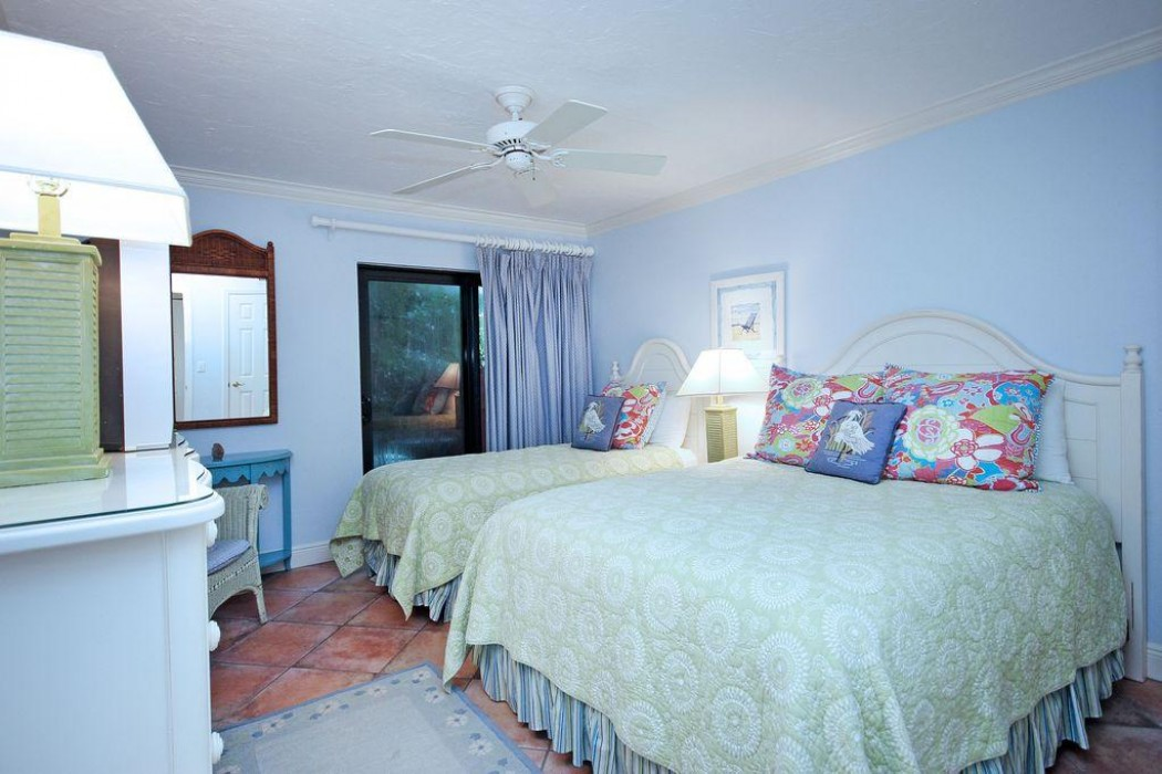 Guest bedroom with a queen size bed as well as twin bed.