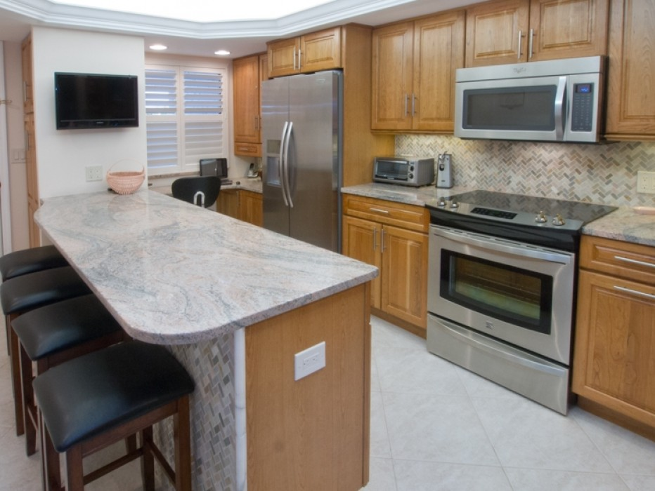 Updated Kitchen with under-cabinet lighting, and Peninsula Island with seating.