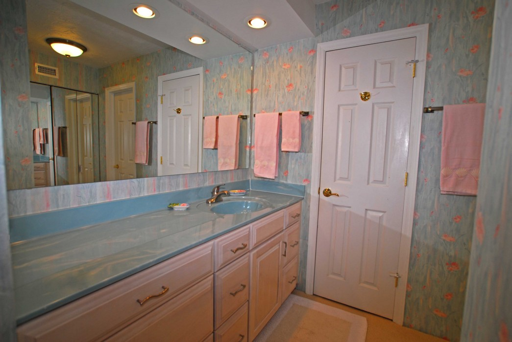 Extra counter space on vanity in Master dressing room, with adjoining room for shower & toilet.