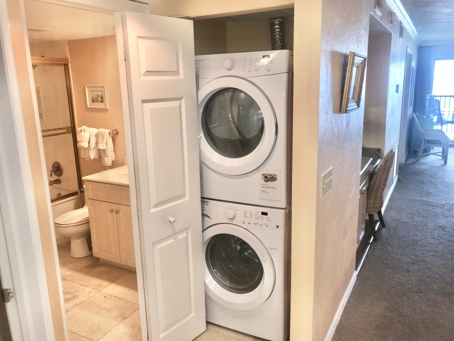 The laundry area with full size washer and dryer