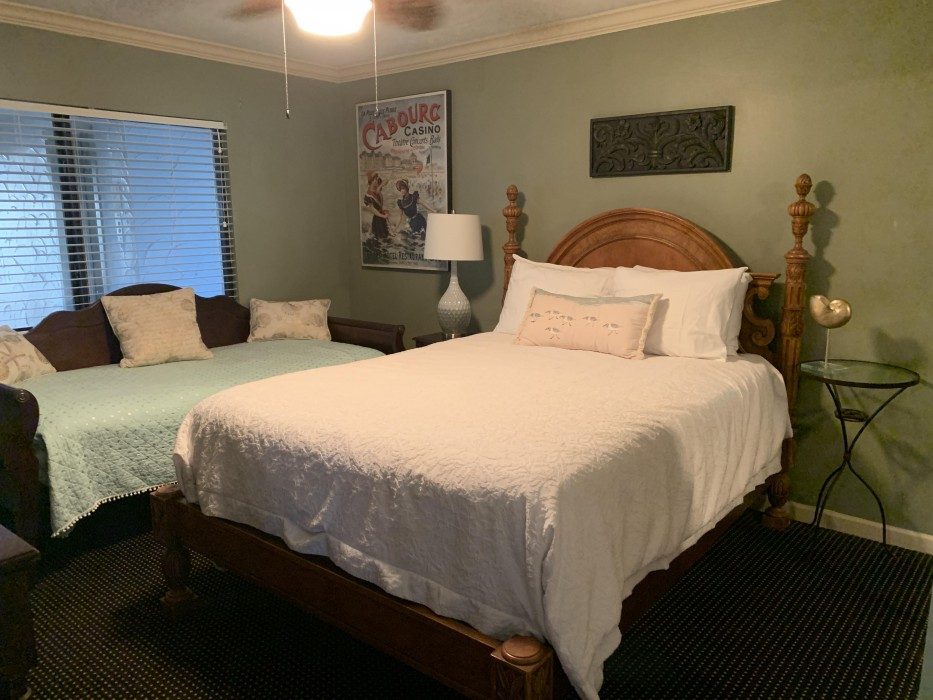 Comfortable queen and twin beds in the guest room, with direct access to bath.