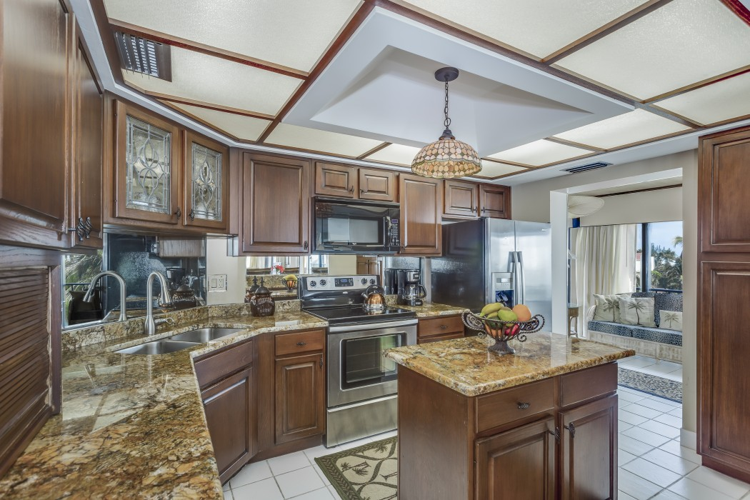 Fully equipped kitchen with granite countertops.
