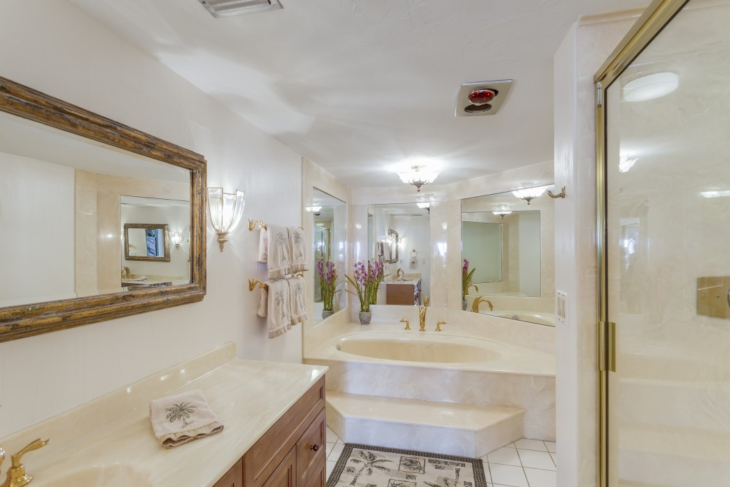 Opulent master suite bath with custom marble throughout.