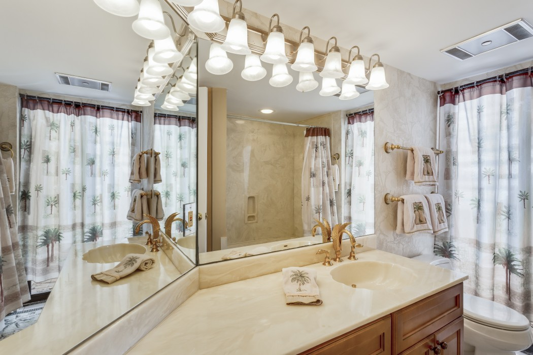Guest bath elegantly decorated includes a bathtub and shower.