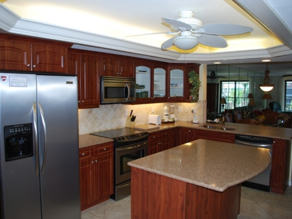 Modern kitchen with spacious granite counters and stainless steel appliances