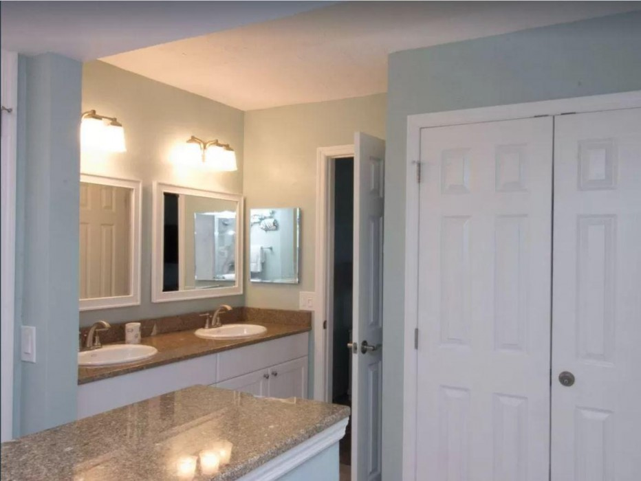 Renovated in late 2017, the master bathroom offers duel sinks, walk in shower and ample closet space.