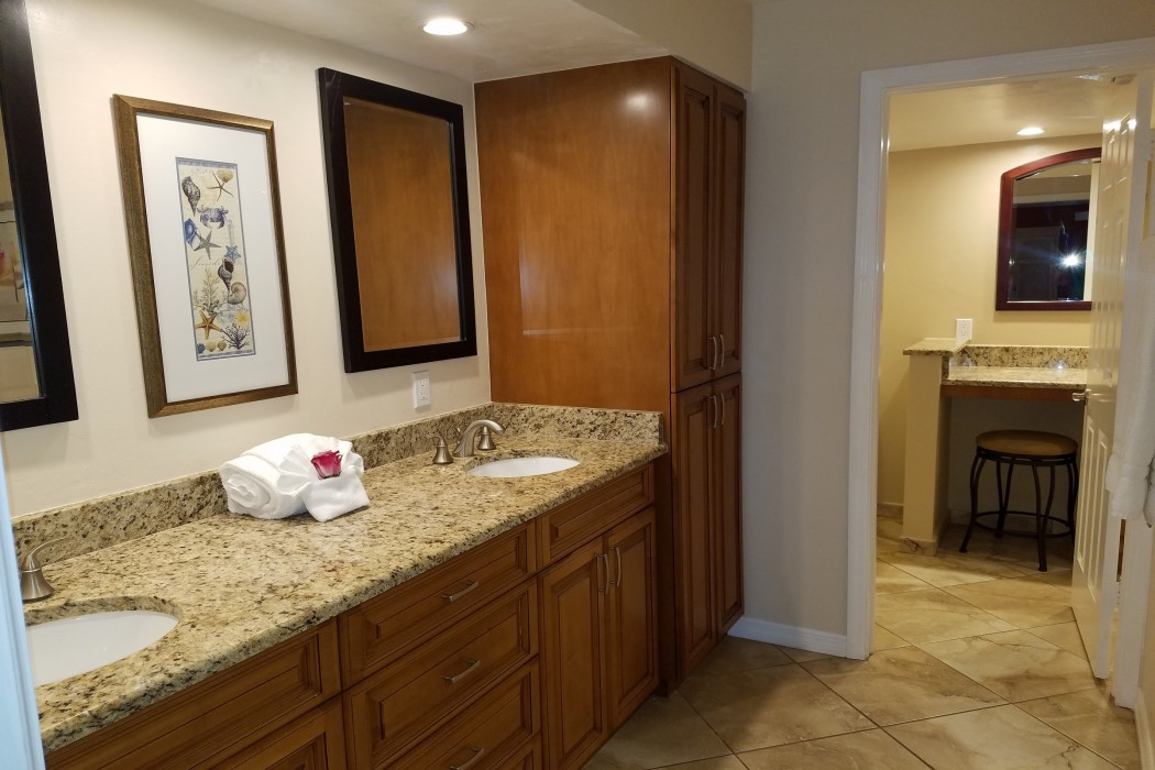 The master bath has a large double vanity and plenty of storage space.