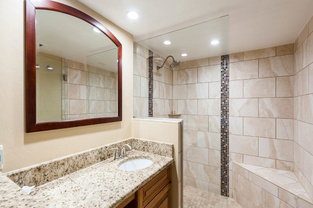The master bath has a convenient vanity sink/makeup seating area and huge walk-in shower!