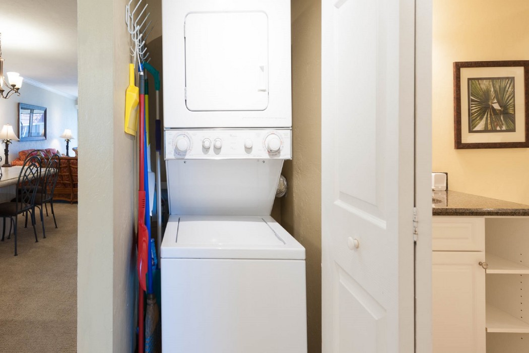 A washer/dryer is conveniently located in a closet by the kitchen.
