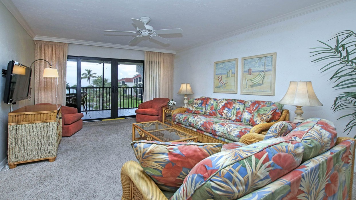 Ceiling fans in the living room and bedrooms allow guests to move the air inside when opening the condo sliders to the evening Gulf breezes.
