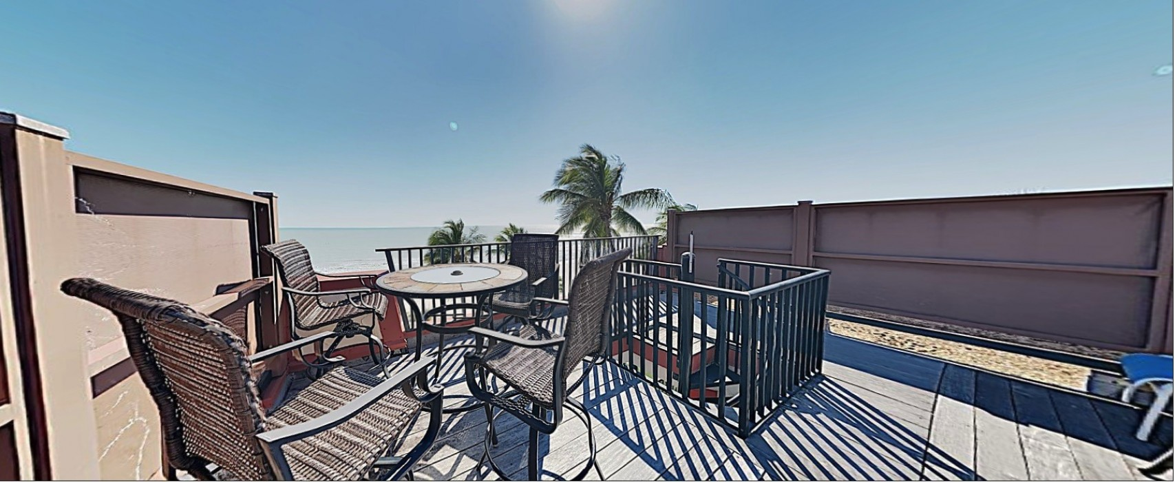 E45: View of the Private Sundeck. 4 Sun loungers and a Bar Table with 4 Chairs