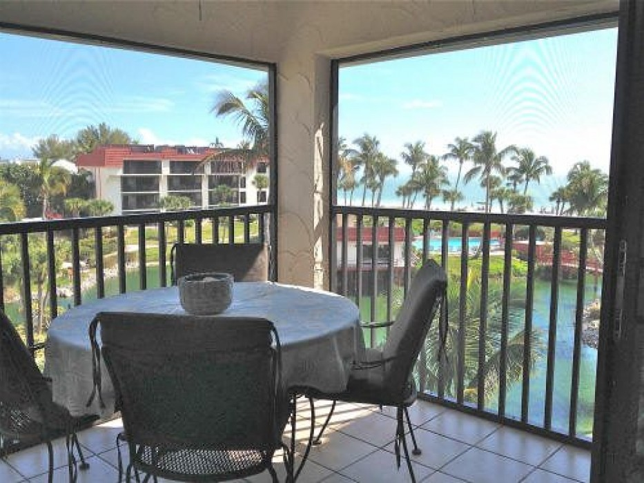 Screened-in lanai with spiral staircase to the sundeck