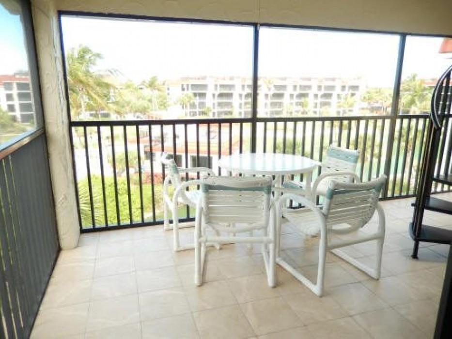 Screen-in lanai overlooking the lagoon and pool