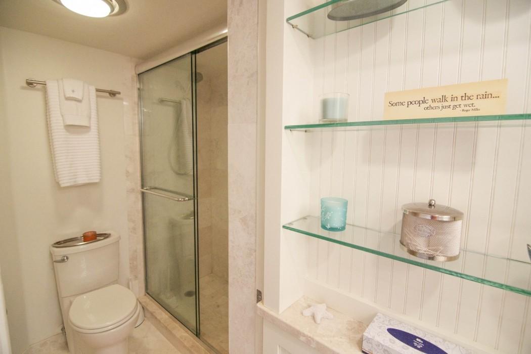 Pocket door separates the shower area from the vanity